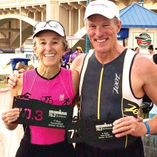 Teresa and Charlie Woodhouse make the podium at Ironman 70.3 Arizona. Teresa's award appears larger than Charlie's because it is. She won first place and he had to settle for third place; something he's become accustomed to by now.