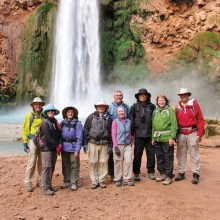 At the base of Mooney Falls, left to right: Frank Earnest, Dianne Ashby, Elaine Fagan, Rob Simms, Phil McNamee, Bertie Litchfield, Ken Wong, Marge Wong and Walt Shields; photo by Stewart Lasseter.