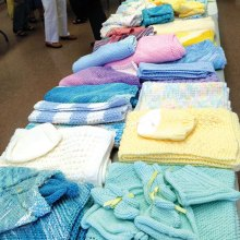 Knitted and crocheted items are displayed at our 2016 event.