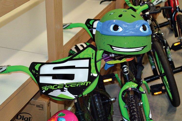 Green helmet and bike