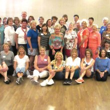 SaddleBrooke community line dancers take a photo break at the March 18 Line Dance with Rebecca spring fundraiser dance.