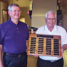 Terry Edwards receiving the Championship Plaque from SMGA President Jack Bowers
