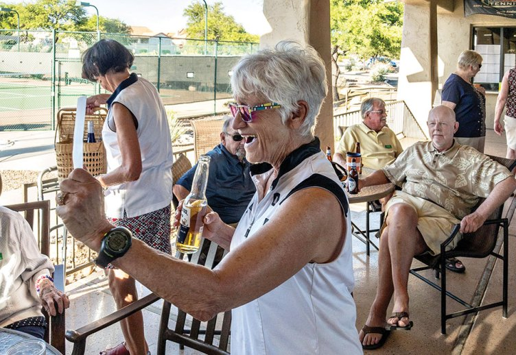 Midge Mollenkopf accepts her award as a member of the winning team at Unit 21's annual golf outing and picnic. Terry Edwards and Larry Wilson were also part of the winning team.