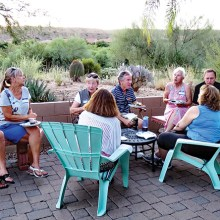 Enjoying the evening on the Branstrom patio. Photo by Ron Talbot.