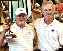SBRMGA President's Cup winner Robert Christianson being presented a trophy by defending champion and SBRMGA Secretary Bruce Deverman.
