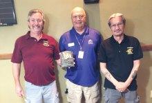 Left to right: Dominic Borland holding the travel plaque, Steve Speckhart and Joe Giammarino