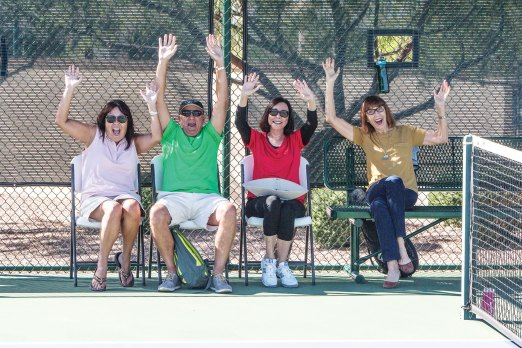 Cheering for a match, left to right: Cathy Johnson, Mark Johnson, Jackie Levitt and Raeone Gilison