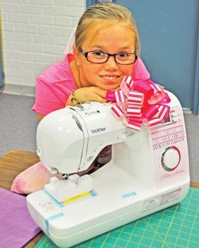 Nevaeh Derrick and her new sewing machine