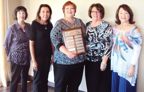 Left to right: Karen Gressingh, third lowest average; Mary Tiemann, Best Attendance; Mary Schlachter, Roadrunner Award; Nancy Galant, most holes in one for fulltime resident and second lowest average; Alyce Grover, most holes in one for a part-time resident. Photo by Deb Lawson