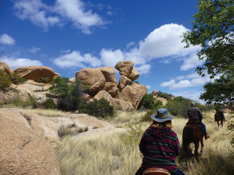 Bob Johnson and Alyce Grover follow the guide past some truly amazing rock formations.