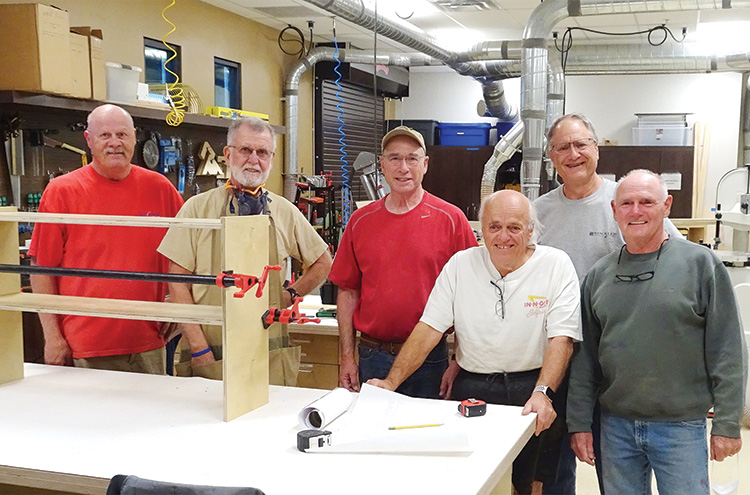 Members of the SBR Woodworkers Club assemble bookcases for the book shelf reading program sponsored by SaddleBrooke Community Outreach (SBCO). From left to right: Ron Gustafson, John Gordon, Ed Cheszek, Jeff Hansen, Dan Carter, Barry Milner; Photo by Steve Groth.