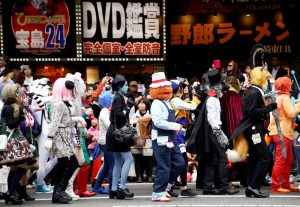 Participants in costumes march during a Halloween parade in Kawasaki