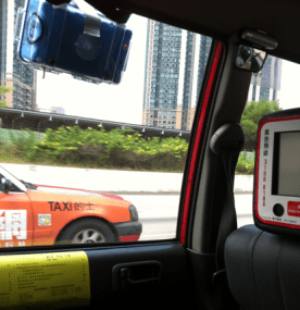 bGeigie happily riding outside Hong Kong taxi window