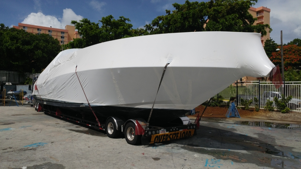 The right side of the boat's tip after shrink wrapped and secured to trailer.