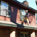 Home inspector examining window