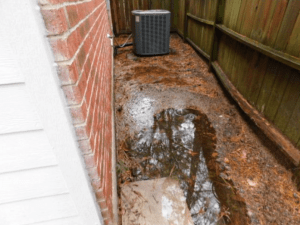 Standing water next to house home inspection issue