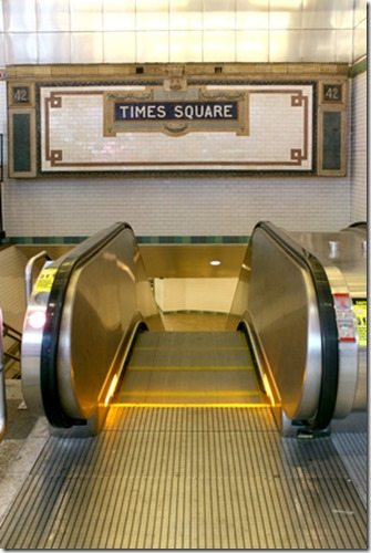 New York City Station subway Times Square sign on tile wall.