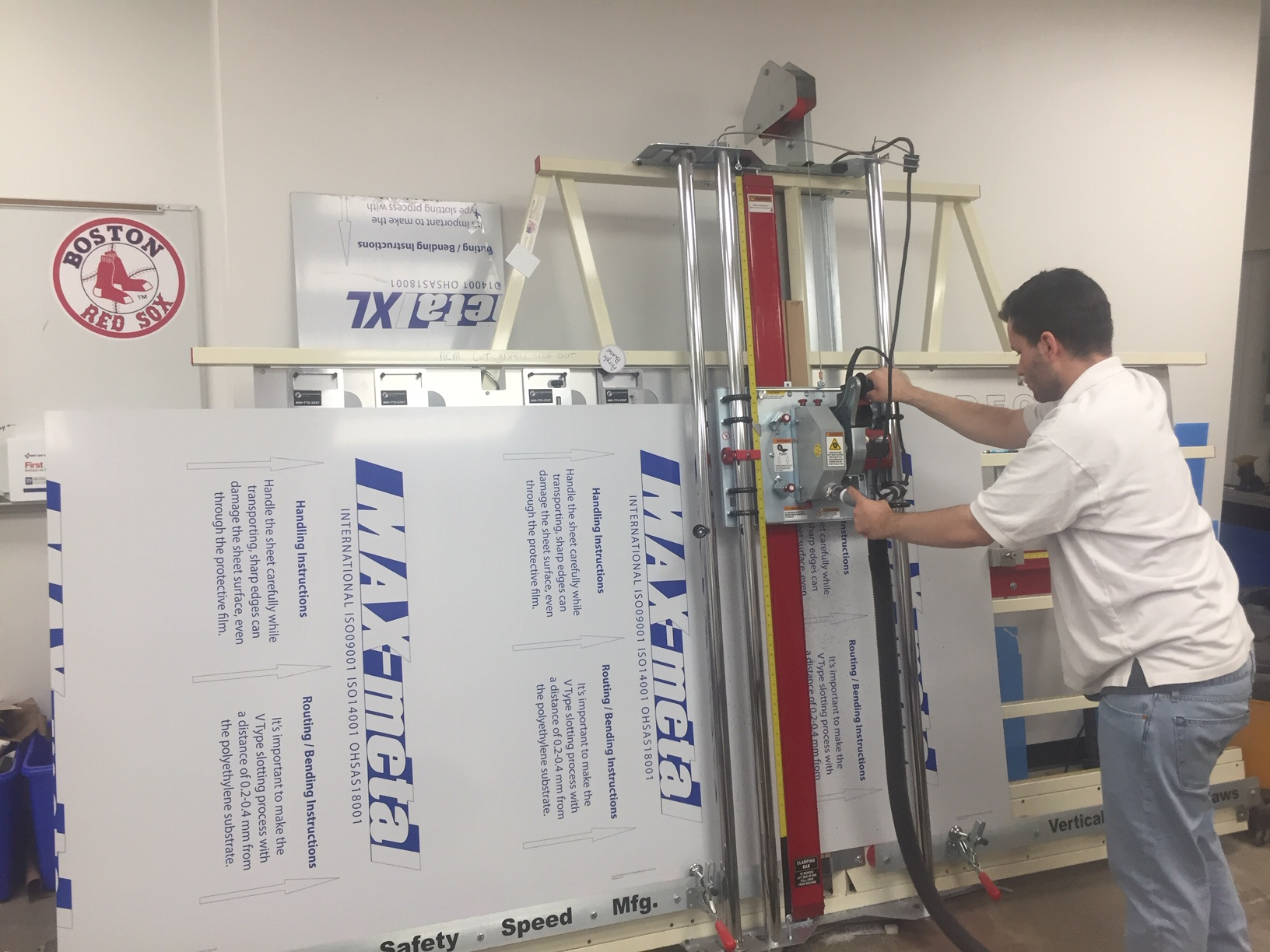 aluminum composite panel and sign making substrates being cut by a vertical panel saw