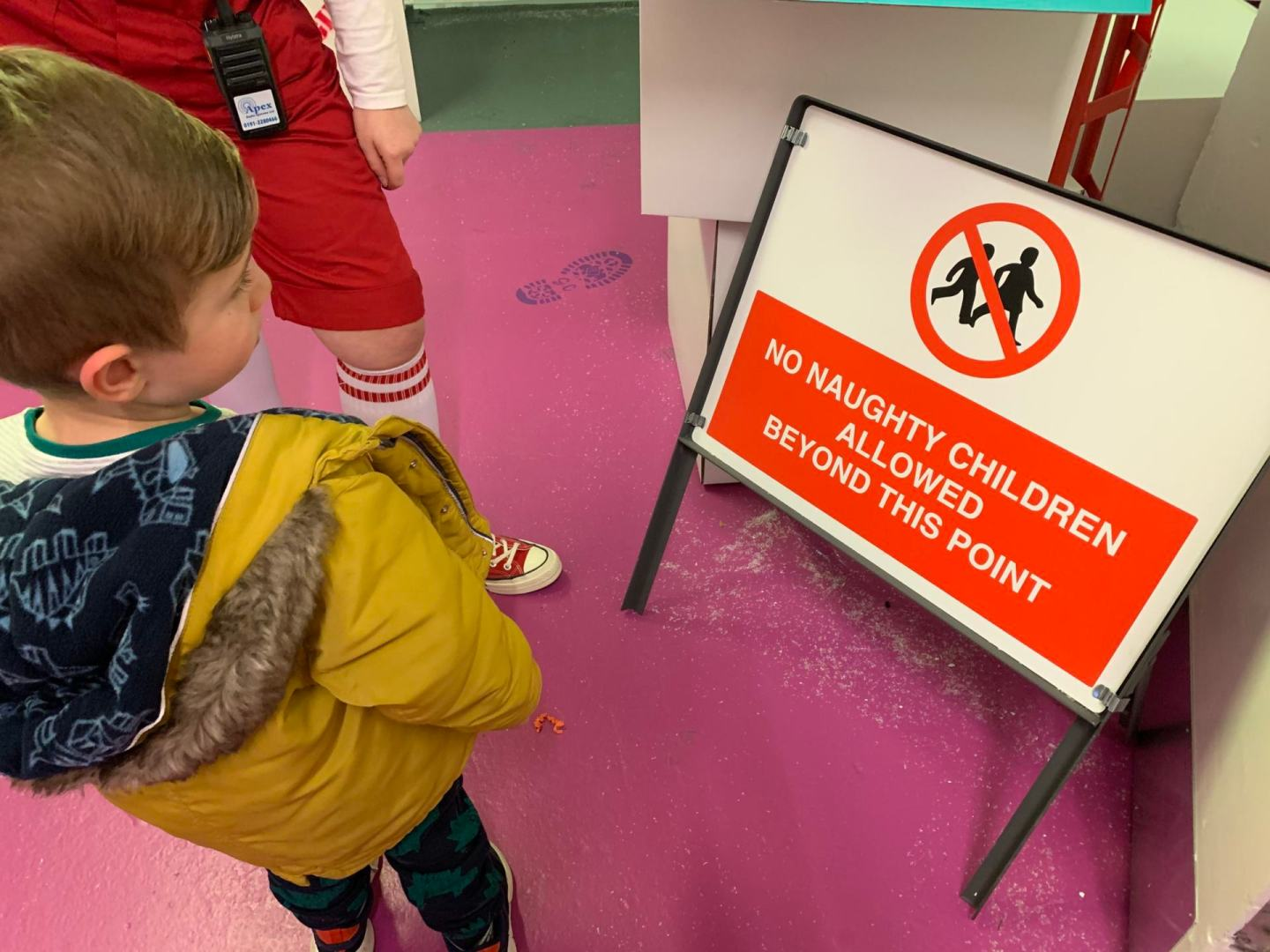Small boy checks out a sign in Fenwick