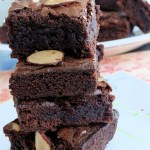 easy breezy fudge brownies with sliced almonds on top