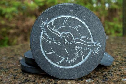 Black Slate round coasters, carved stone hawks