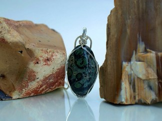 green stone with black circles