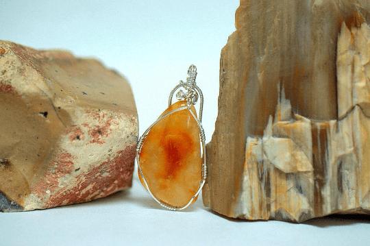 transparent red orange gemstone