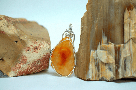 transparent red orange gemstone