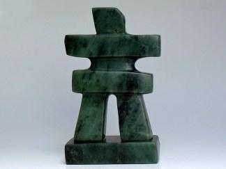 Spread arm human figurine stone carving