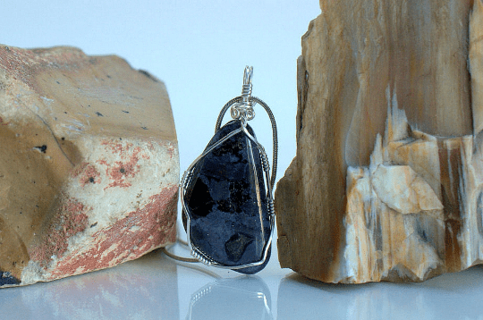 blue stone with red crystal pendant