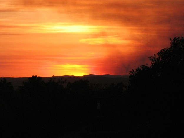 Las Pulgas fire at sunset