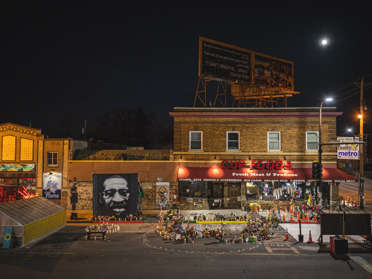 A bird's eye view shows George Floyd's memorial at 38th and Chicago following a candlelit vigil on Sunday, March 28, 2021.