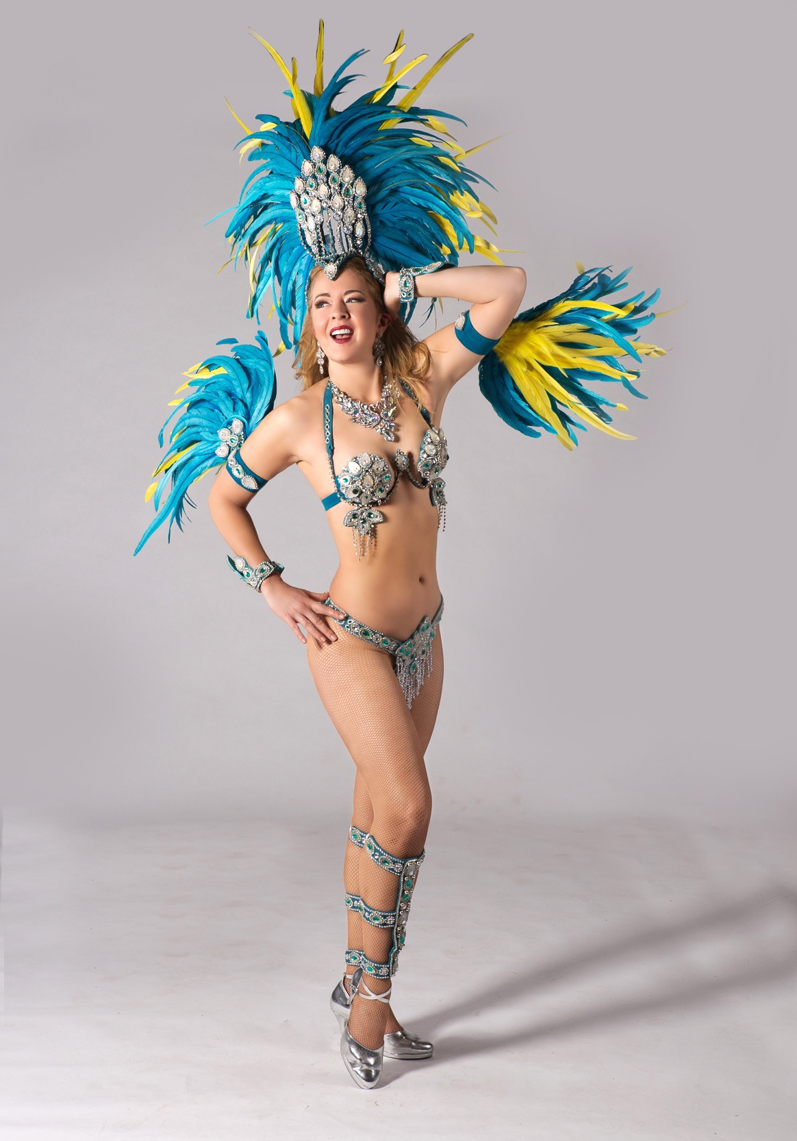 Vancouver Samba Dancer poses in Blue and Yellow samba costume by Miss Glamourosa