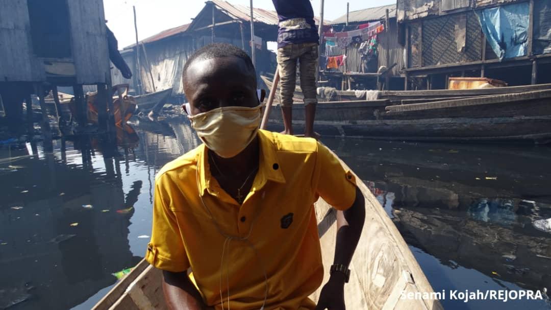 Moses Stephen (Bobo) is a fisherman turn tour guide in Makoko.