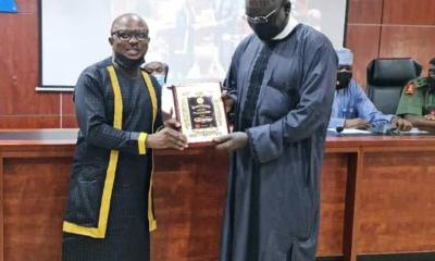 """In a brief ceremony on March 11 at the Army Resource Centre, Asokoro, Abuja, where the President of the online media association, Mr. Femi Oyewale presented a plaque of honour to the Ambassador Designate, Buratai thanked the association's leaders and members for considering him for such enviable position. He re emphasized the importance he attaches to the media as useful partners in nation building. He reinstated his determination to always co operate with the media, in any way possible, for a better and safer Nigeria. Buratai urged NAOSRE not to relent in its patriotic efforts at promoting unity and harmony between citizens and security operatives through professional and unbiased reportage. """"I thank NAOSRE leadership and members for being here today to involve me as the association's Grand Patron for a better and safer Nigeria. The unity and peaceful co existence of our dear country is what I have always worked for. I will continue to support anything that will make Nigeria safer and secured even outside office as Chief of Army Staff. """"I also want to use this opportunity to thank President Muhammadu Buhari for the confidence he reposes in me. I will never betray that confidence and I will not disappoint the Commander-in-Chief in any position of trust I am assigned from time to time,"""" Buratai stated. Earlier in his presentation, Oyewale described General Buratai as radiating Warren Bennis's philosophical definition of leader as a servant with capacity to translate vision into reality. He said """"Of a truth, His Excellency, General Ambassador Dr Tukur Yusuf Buratai epitomized and exhibited those leadership skills as Chief Of Army Staff. We are sure he will do more in subsequent assignments."""" Oyewale disclosed that the idea to choose Buratai as NAOSRE Grand Patron is a product of the association desire to minimize errors in its pursuit of creating harmony between citizens and military operatives. He said, """"With an experienced General like Buratai as NAOSRE Grand Patron"""