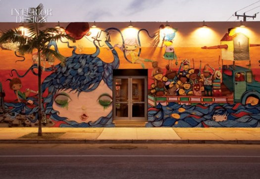 367095-An_existing_spray_painted_mural_by_the_duo_Osgemeos_had_to_be_altered_to_make_room_for_front_doors_when_the_warehouse_was