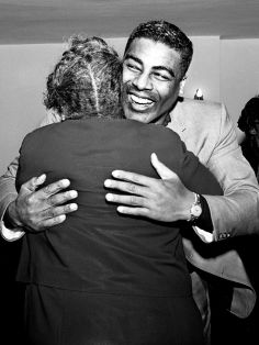 """The Rev. Kelly Miller Smith, center, is enthusiastically greeted by a well-wisher upon his return back home Dec. 30, 1963 from Cleveland, Ohio. Rev. Smith, one of Nashville leaders in the fight for integration, returns to First Baptist Church after leaving last fall for the historic Antioch Baptist Church in Cleveland. Rev. Smith said he is back in Nashville """"for good."""" Dale Ernsberger / The Tennessean"""