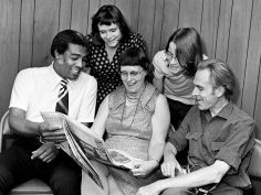 Mrs. Jan Vuijst, center, from Holland and her husband, The Rev. Vuijst, right, appear amused at a story and picture in a Nashville newspaper that the Rev. Kelly Miller Smith, their Nashville host, is showing them Aug. 3, 1973. Behind them are children of the couple, Frake, left, a journalist, and Peter. Rev. Vuijst, a Dutch Reform Church pastor in Holland, is in Nashville visiting Rev. Smith and sharing the services at the first Baptish Church, Capitol Hill, where Smith is pastor. Frank Empson / The Tennessean