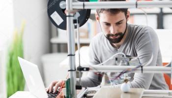 engineer using a  printer