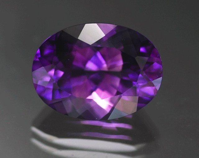 Violetish purple amethyst, 8.55 cts, 16 x 12 mm, oval brilliant, Jackson's Crossroads, Wilkes Co., Georgia. © The Gem Trader.