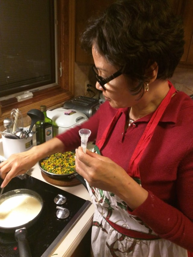 Mom taking the AncestryDNA test while cooking us dinner.
