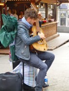 I hope he can buy a new guitar with his earnings!