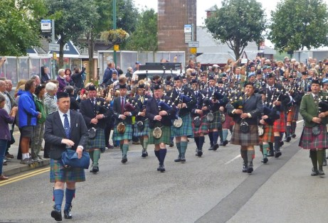 Duke of Argyll leading the pipers