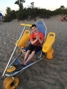 Young man sitting in a beach buggy