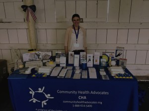 SAIL employee working at an informational booth at an event
