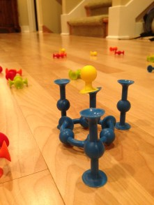 Squigz! These suction cup building blocks will allow Claire to construct houses and towers that will stand tall even when the boat is heeled 45 degrees!