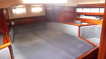 Our well-appointed aft stateroom, with a surprising amount of shelves, drawers, lockers and storage areas, not to mention a TV