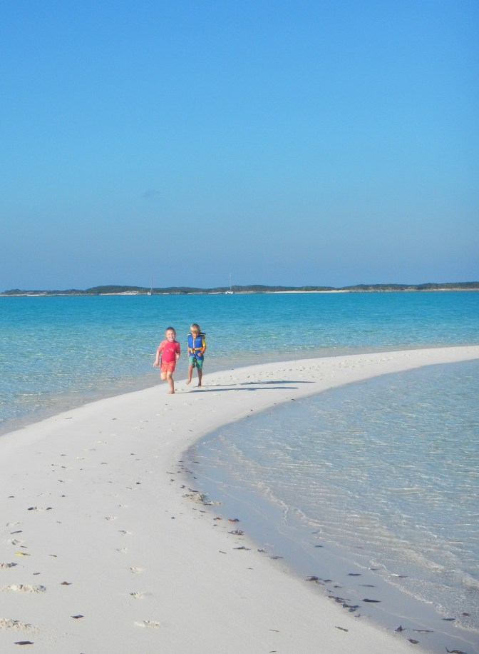 Claire and her friend Ethan on S/V Mahi, running on a low-tide crescent-shaped beach off of Shroud Cay in the Exuma Land and Sea Park. We cruised with their lovely family for most of our time in the park before we continued south and they headed north to the Berry Islands.
