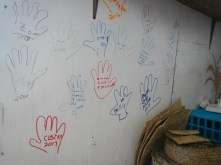 Claire traced her hand and wrote her name on the shop wall, forever marking our visit there.