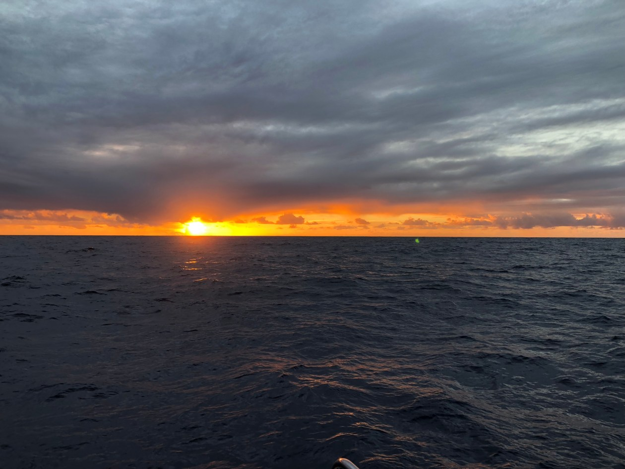 Sunset and clouds in South Atlantic ocean
